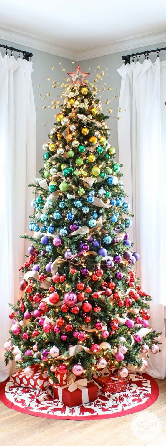 artificial tree idea for decorating artificial Christmas trees.  What a unique and unusual colorful xmas tree from @involvery https://www.pinterest.com/involvery/fake-christmas-tree-ideas-artificial-christmas-tre/