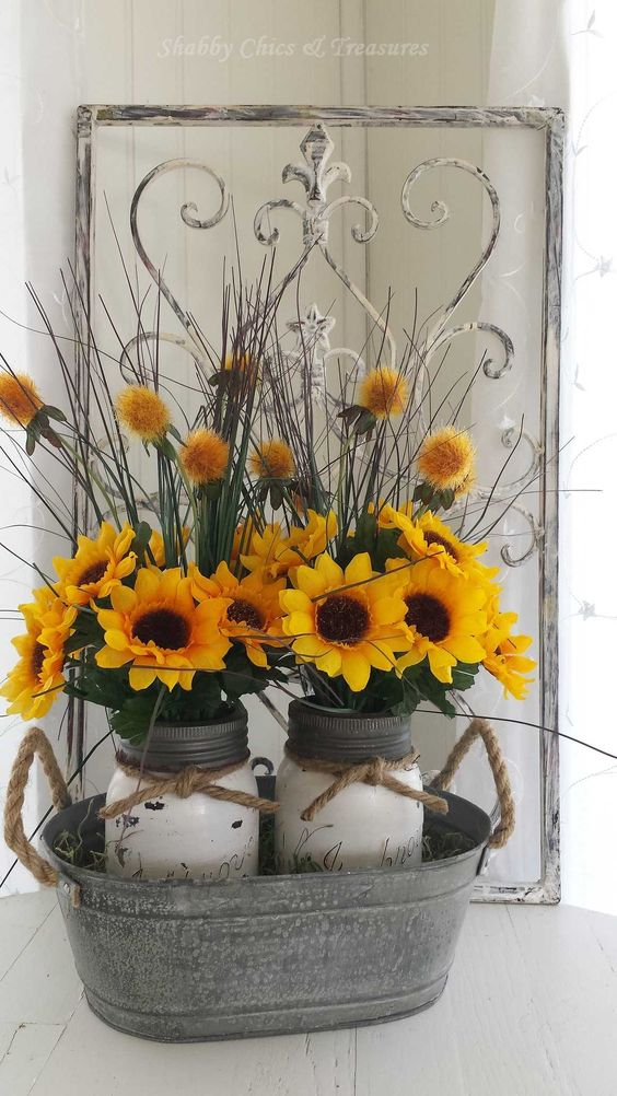 painted mason jars with sunflowers in a galvanized tub