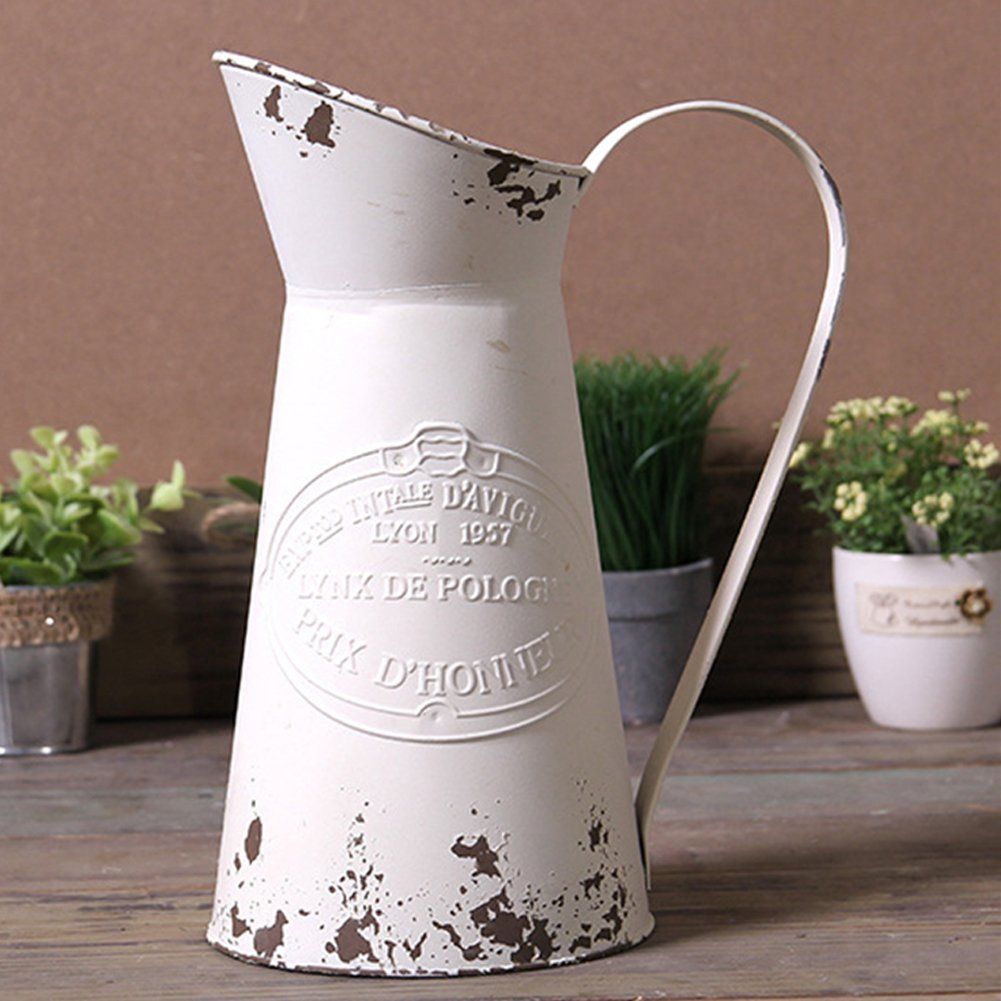 shabby chic rustic pitcher for flowers in my kitchen.